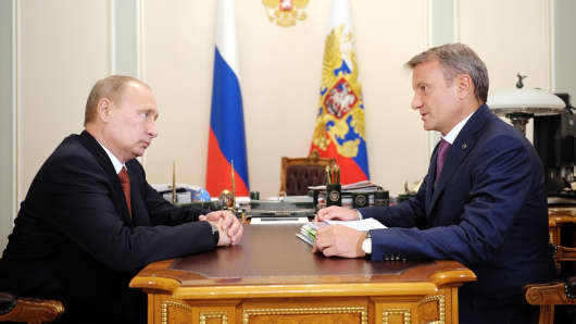 President Putin, left, meeting Sberbank's chief excutive German Gref in October