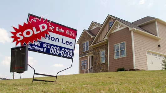 A for sale sign is displayed outside of a new home in Clayton, North Carolina, U.S.