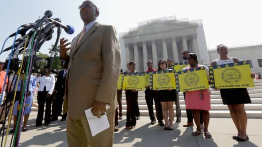 Field Director Charles White of the National Association for the Advancement of Colored People (NAACP) speaks at a podium outside the U.S. Supreme Court building on June 25, 2013 in Washington, DC.