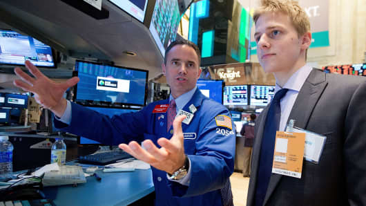 John Petrie (R), a winner of the InvestWrite Essay Competition, tours the NYSE.