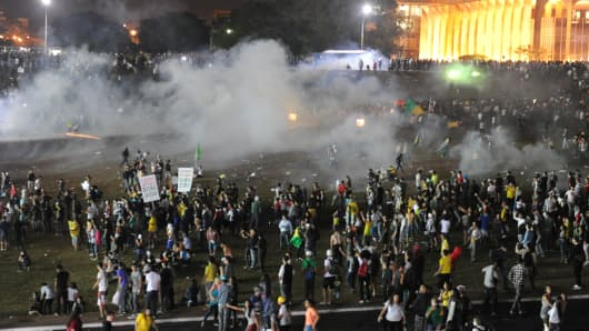 Police employ tear gas against demonstrators during a protest against government waste,corruption and the use of public funds in Brazil on Wednesday.