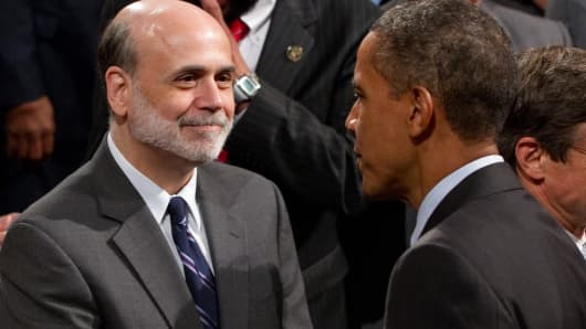 President Barack Obama shakes hands with Chairman of the Federal Reserve Ben Bernanke.