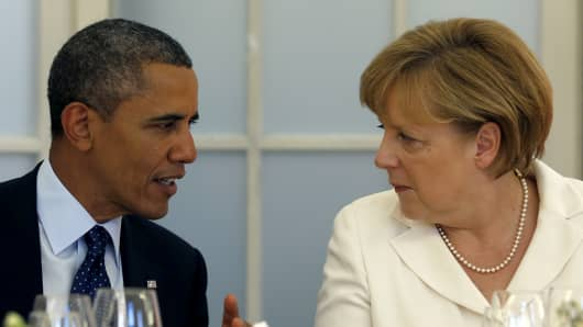 President Barack Obama speaks with Chancellor Angela Merkel.