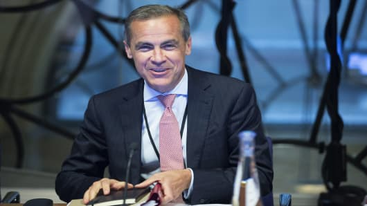 Mark Carney, governor of the Bank of England, is all smiles on first day in charge.