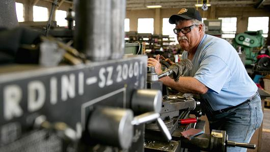 Employee Thomas Rutkowski operates a manual lathe machine at the Ellicott Dredges LLC manufacturing facility in Baltimore, Maryland, U.S.