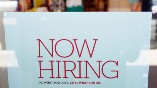 An employment sign is placed in the window of Banana Republic clothing store on June 21, 2013 in Pasadena, California.