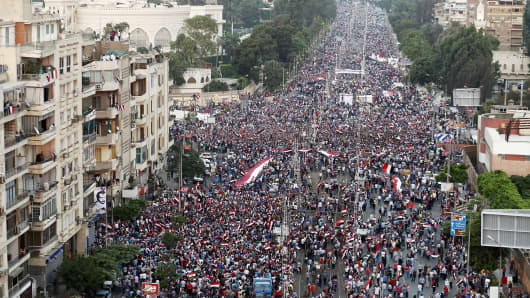 Hundreds of thousands of Egyptian demonstrators gather at the presidential palace during a protest calling for the ouster of President Mohamed Morsi on July 1, 2013 in Cairo.