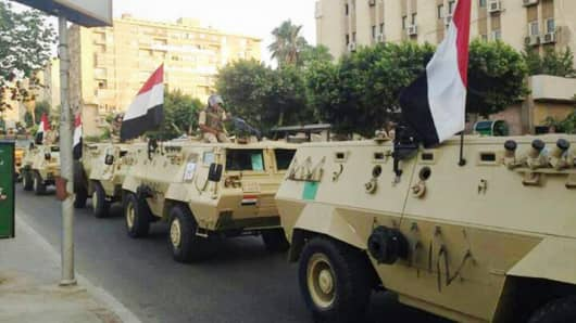 Egyptian military armored vehicles begin to enter central Cairo on July 3, 2013.