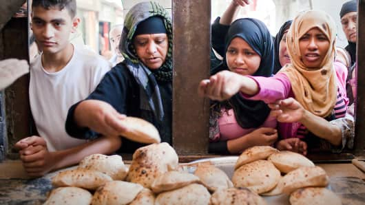 Customers buying bread in Cairo, Egypt.