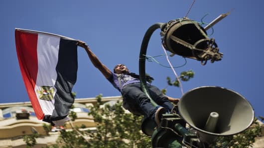 Egyptian opposition protester celebrates on news the Egyptian military will be temporarily taking over from the country's first democratically elected president Mohammed Morsi.