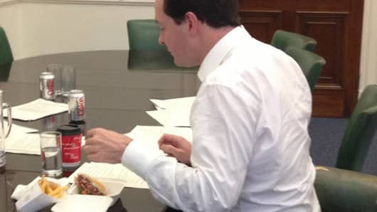 George Osborne putting final touches to a speech with the help of a Byron burger