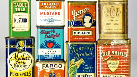 Old vintage mustard tins on display that the Mustard Museum.