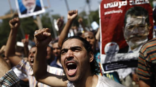A supporter of the Muslim Brotherhood and ousted president Mohamed Morsi shouts during a protest