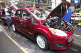 A Ford C-MAX hybrid goes through the assembly plant in Wayne, Mich.