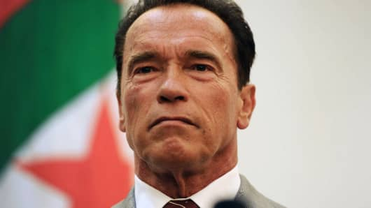 Former Governor of California and founding chair of the R20 initiative - Regions of Climate Action, Arnold Schwarzenegger attends a press conference with Algerian Minister of Planning and Environment, Amara Benyounes (not in picture) in Algiers on June 25, 2013.