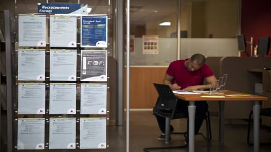 A jobseeker fills out a document inside a job center in Toulouse, France.
