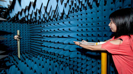 An engineer at Spreadtrum Communications Inc., tests a mobile phone in an Antenna Mesurement System (anechoic chamber) at the company's facility in Shanghai, China.