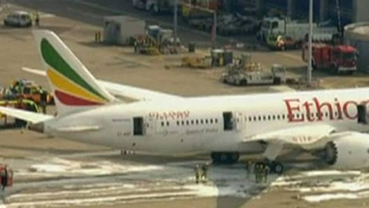 An Ethiopian Airlines Dreamliner jet caught fire at Heathrow Airport in London on July 12, 2013.