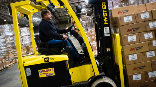 An employee operates a forklift at the distribution center of the Oregon Freeze Dry facility in Tangent, Oregon.