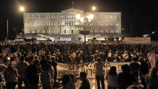 Demonstrators protest against the Greek Government, July 17, 2013 in front of the parliament as lawmakers prepared to vote on a controversial new austerity package.