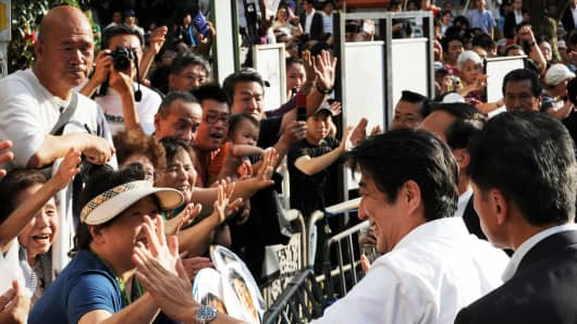 Japanese Prime Minister and ruling Liberal Democratic Party leader Shinzo Abe with supporters.