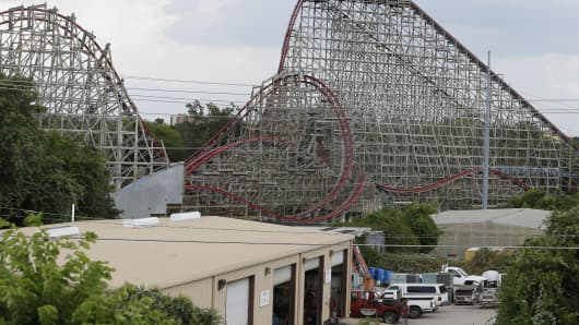Investigators will try to determine if a woman who died while on The Texas Giant roller coaster at Six Flags Over Texas fell from the ride. Some witnesses said she wasn't properly secured.