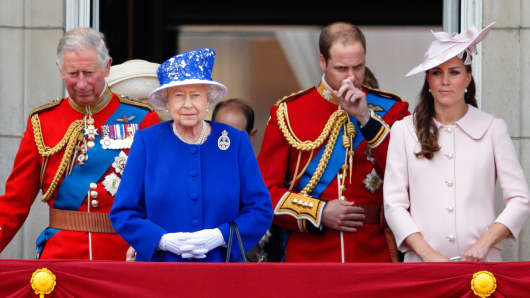Prince Charles, Prince of Wales, Queen Elizabeth II, Prince William, Duke of Cambridge and Catherine, Duchess of Cambridge stand on the balcony of Buckingham Palace during the annual Trooping the Colour Ceremony on June 15, 2013 in London, England.