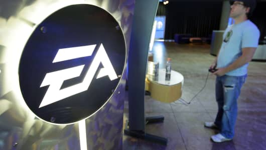 An attendee tries out a Electronic Arts Inc. video game during the annual Studio Showcase media event at the company's headquarters in Redwood City, California.