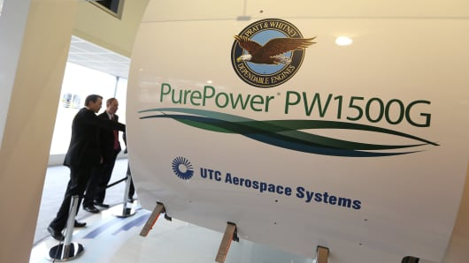 Visitors look at a PurePower PW1500 aircraft engine manufactured by Pratt & Whitney, a unit of United Technologies Corp.
