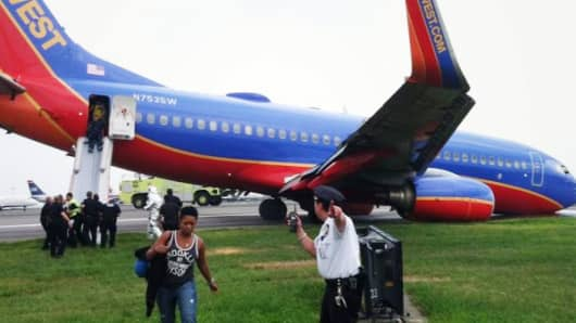 Southwest Airlines Flight 345, a Boeing 737 arriving at LaGuardia from Nashville reported possible front landing gear issues before landing. The plane's nosegear collapsed as the aircraft landed on Runway 4 at 5:45 p.m. EDT. The plane safely came to a stop and no injuries were reported. The FAA is investigating.