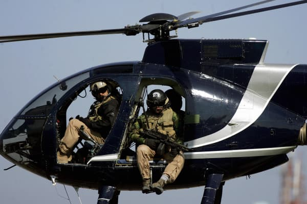 in a file picture dated 05 February 2005, members of the US-based Blackwater private security firm scan Baghdad city centre from their helicopter.