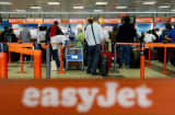 Passengers queue up at the EasyJet counter at Berlin's Schoenefeld airport