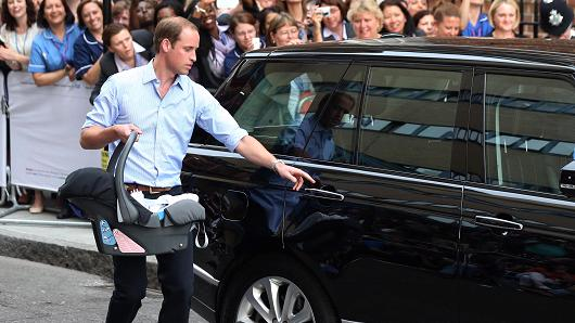 Prince William, Duke of Cambridge, leaves the Lindo Wing of St. Mary's Hospital in London with his newborn son.