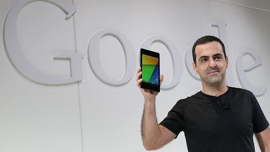 Hugo Barra, Vice President, Android Product Management at Google, holds up a new Asus Nexus 7 tablet .