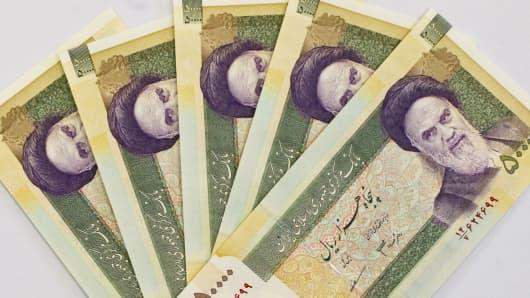Iran's 50000 Rials with a portrait of Ayatollah Ruhollah Khomeini.