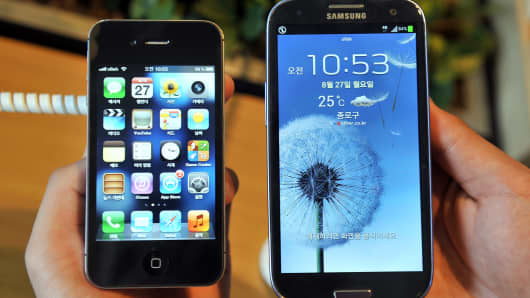 A Samsung Galaxy S4 and an Apple iPhone 5
