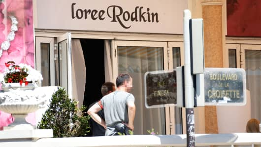 French policemen investigate outside the Carlton Hotel on July 28, 2013 in the French Riviera resort of Cannes.