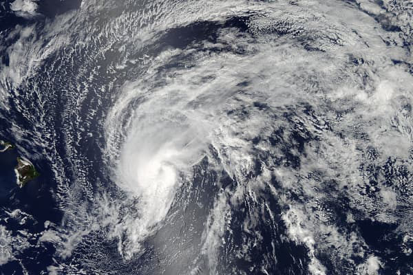 The MODIS instrument that flies aboard NASA's Aqua satellite captured this image of Tropical Storm Flossie on July 28 at 23:10 UTC (7:10 p.m. EDT) as it continued moving toward Hawaii (left).