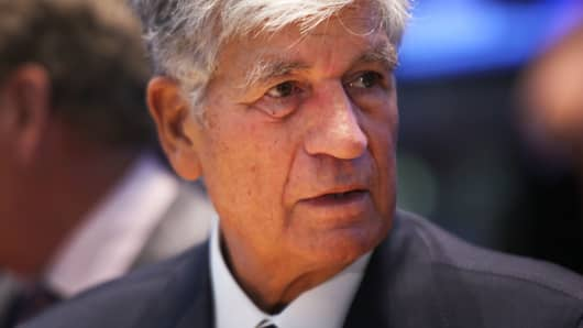 Publicis CEO Maurice Levy stands on the the floor of the New York Stock Exchange a day after announcing that Omnicom Group and Publicis Groupe will merge to form the world's largest advertising holding company on July 29, 2013 in New York City.