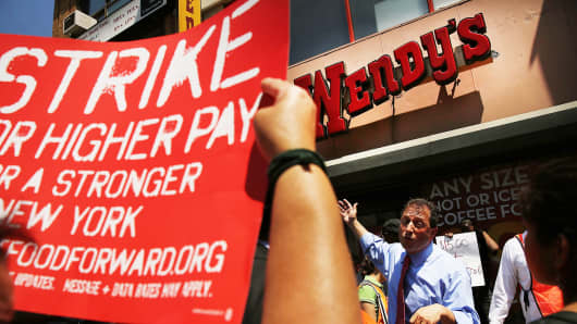 New York City Councilman Brad Lander speaks to employees at Wendy's fast-food restaurant during a demonstration outside of one of the restaurants to demand higher pay and the right to form a union on Monday in New York City.