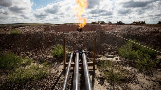 A gas flare is seen at an oil well site outside Williston, North Dakota.