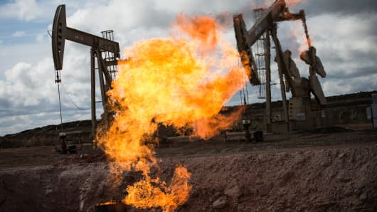 A gas flare is seen at an oil well near Williston, North Dakota.