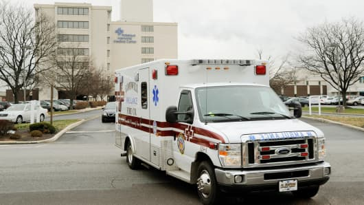An ambulance leaves Community Health's Pottstown Memorial Hospital in Pottstown, Pennsylvania.