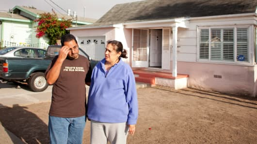 Robert and Patricia Castillo in front of their home that they purchased for $420,000, and is now worth $125,000, they said, in Richmond, Calif., July 26, 2013.