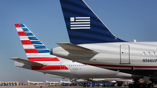 An American Airlines plane (left) and a USAirways jetliner at Dallas-Fort Worth.