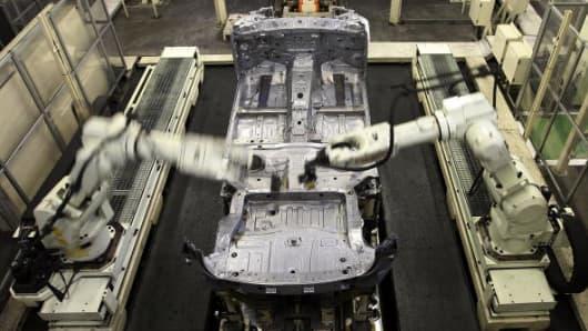 Arm robots assemble parts at Nissan Motor's Tochigi Plant in Japan.