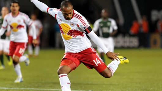 Thierry Henry #14 of New York Red Bulls puts a shot on goal during the second half of the game against the Portland Timbers at Jeld-Wen Field on March 03, 2013 in Portland, Oregon.