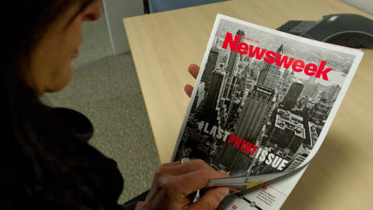 This December 24, 2012 photo shows a woman perusing the final print edition of Newsweek in Washington, DC.