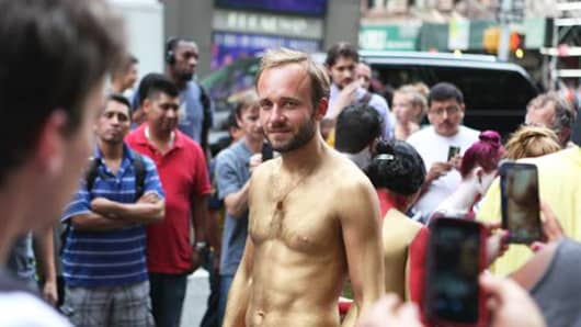 Kirill, a nudist who declined to give his full name, participates in a public body painting event by artist Andy Golub near New York's Times Square on July 31, 2013.