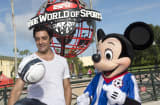 French-born model and actor Gilles Marini poses with Mickey Mouse at ESPN Wide World of Sports at Walt Disney World Resort in Lake Buena Vista, Florida